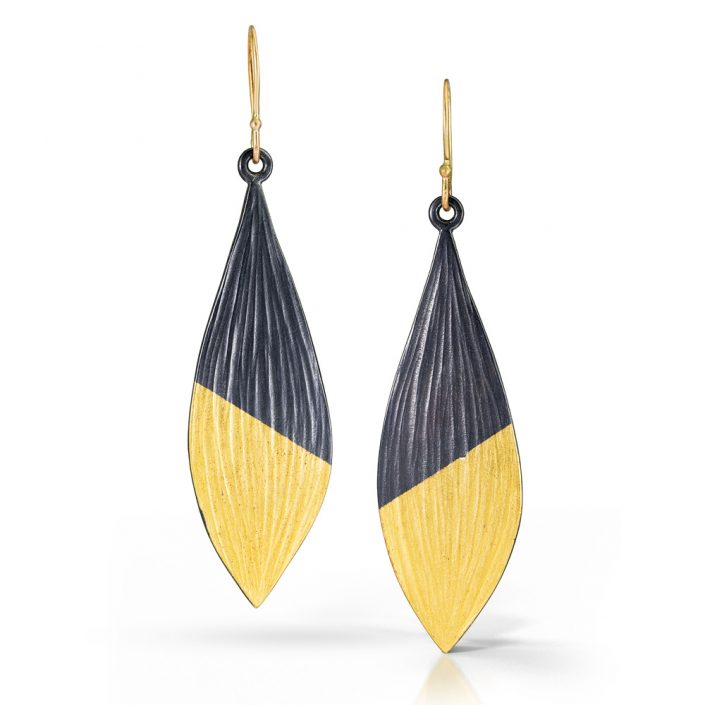 Gold and silver earrings by Kendra Renee