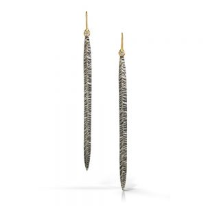 Long and lean silver and gold stiletto earrings