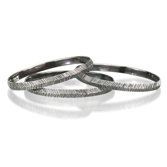 Silver oval bangles by Kendra Renee